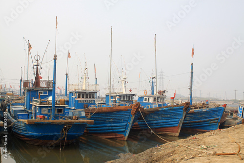 fishing boats anchored along the shore