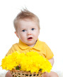 cute baby boy holding basket with yellow flowers