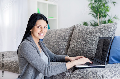 Woman working with computer at home