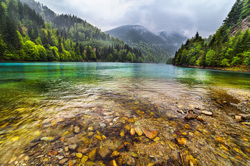 Lake in mountains, in a rainy day