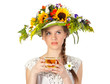 Beautiful girl in hat of flowers and cup of tea