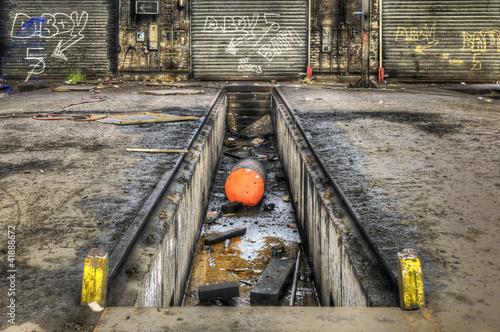 Staande foto Industrial geb. Inspection pit in an old abandoned garage