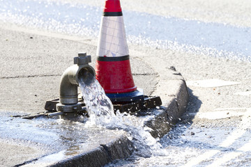 Water being released while a water main is repaired