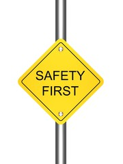 safety first yellow road sign on white background