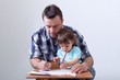 Toddler boy drawing with his father