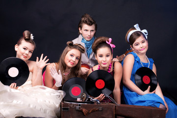 five teenages with records and gramophone