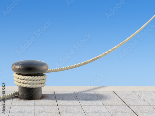 Old bollard with the rope - 41892429