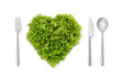 heart-shaped salad, lettuce with fork, spoon, knife