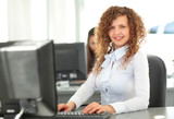 Adult young pretty business woman working at her office. poster