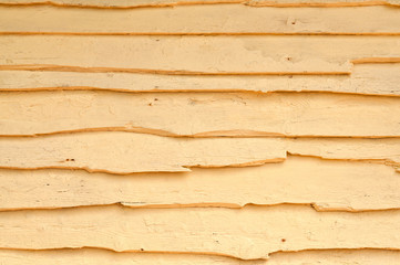 Old yellow painted wooden wall