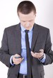 Young business man with smart phones