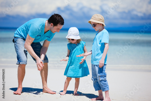 Father and kids at beach