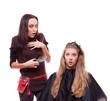 studio shot of shocked hairdresser and client