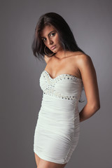 beautiful and sensual latin woman,in a white dress