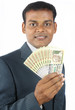 indian business man holding indian money