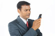 Depressed Indian Businessman with Mobile