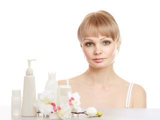 A young woman with cosmetic products