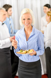 Smiling business woman during company lunch buffet poster