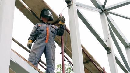 Worker Welding on a Metal Construction