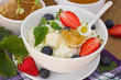 Dietary cheese with honey, blueberries and strawberry