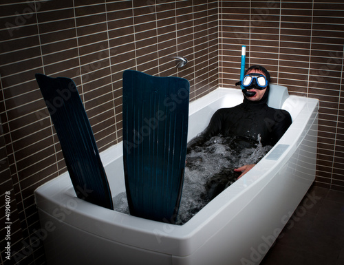 Fotobehang Duiken Bizarre dive immersion in bathtub