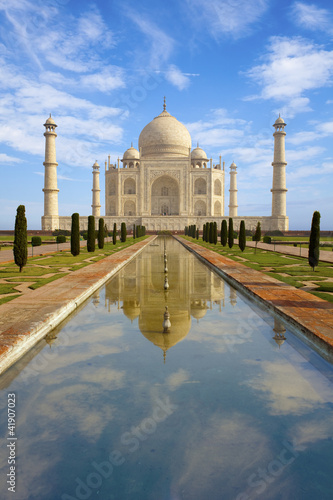 Taj Mahal at sunrise, reflecting in the pond, India