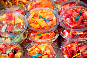 Colorful fruit salad in transparent glasses