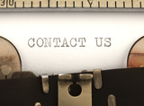 contact us, on the typewriter