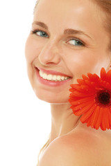 A beautiful woman with a red gerbera, close-up