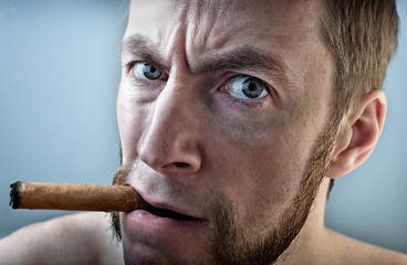 a man with a cigar