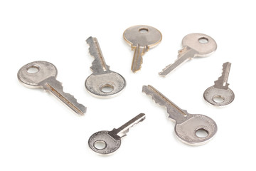 Many metal keys isolated on white