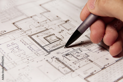 Pencil in hand on building plans