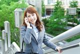 Beautiful business woman walking outside her office