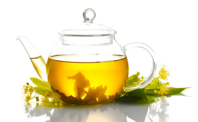 teapot of linden tea and flowers isolated on white