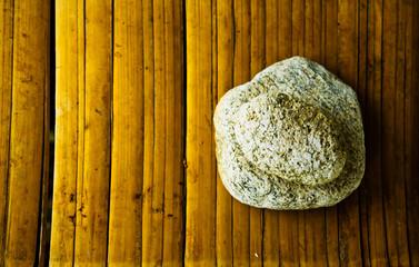 rocks on bammboo mat