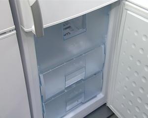 refrigerator cabinet door open. product demonstration in store