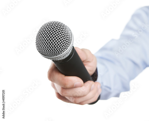 Male hand holding microphone for the interview