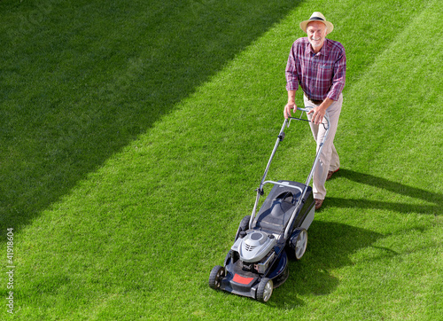 mowing senior man