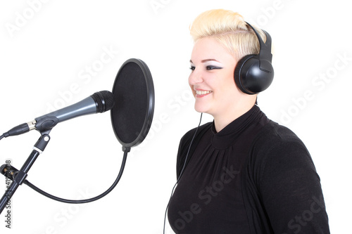 Happy blonde woman with microphone