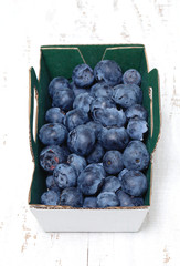 blueberries in a box on wooden table