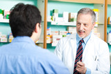 Pharmacist dealing with a customer