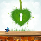 Heart of grass with keyhole over landscape