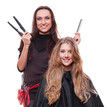 studio shot of smiley hairdresser with straighteners