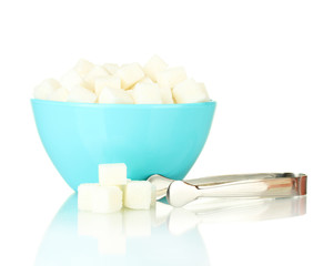 White lump sugar in bowl with sugar-tongs isolated on white