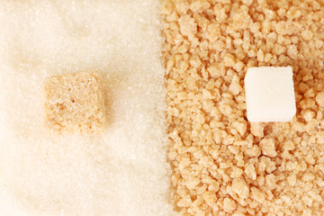 Pattern of white sugar and brown sugar close-up