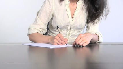 woman writing white paper