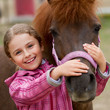 canvas print picture - Horse whispers - Horse and lovely girl - best friends