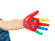 Coloured hand of a child with a lot of colours