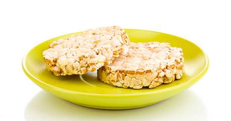 Bread snacks on saucer isolated on white