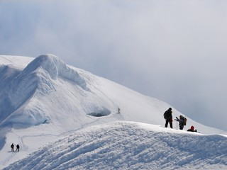 Climbers on edge of crater of volcano Beerenberg, Jan Mayen